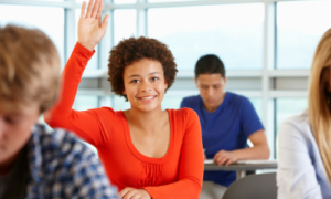 Student with hand raised